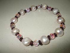 Hey, I found this really awesome Etsy listing at https://www.etsy.com/listing/83618131/pink-potato-pearl-stretch-bracelet