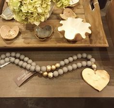 Sercy Studio Blessing Beads with wooden beads and a gold heart. Wood Bead Garland, Beaded Garland, Garlands, Wooden Bead Necklaces, Wooden Beads, New Crafts, Arts And Crafts, Garland Ideas, Jewelry Displays