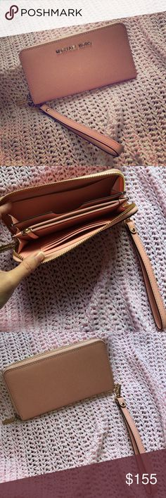 Michael Kors wallet No flaws. Looks new. I purchased this from the Michael Kors store in Portland Oregon. I just never use it. Does NOT fit an iPhone 6plus. May fit a smaller phone. Salmon pink color. NO TRADE, NO PAYPAL. No lowball offers. Thanks for looking :) Michael Kors Bags Wallets