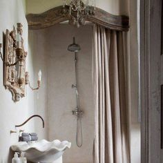 I want one just like this! A corona over the shower curtain, the sconces and mirror, the sink - fabulous!
