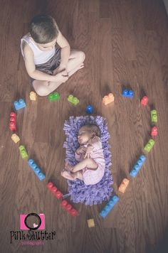 Brother and baby sister :) Would also look cute with ho wheel cars around her