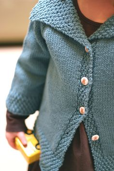 I LOVE this pattern. It really CAN be boy OR girl! I love the peter rabbit buttons she's wearing too! Super cute! :D
