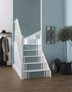 The subtle differences in the blue tones and white edging adds an exciting twist: Blank Canvas, Naughty Step and Monday Blues. The simple, yet eye catching scheme is perfect for creating a real statement as soon as you walk through the front door. Hallway Wall Colors, Hallway Colour Schemes, Stairs Colours, Grey Hallway, Front Hallway, Hallway Walls, Tiled Hallway, Modern Hallway, Duck Egg Blue Hallway
