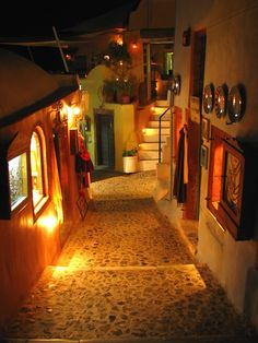 Oia at night. There's nothing like an evening stroll through the village of Oia at night.