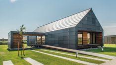 Une maison ossature bois danoise et son bardage en verre recyclé,  #construiretendance