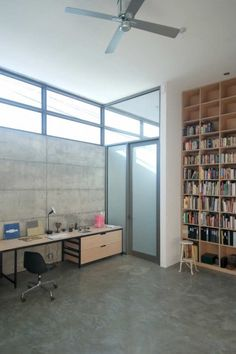 long desk in high space Love the tall ceilings and bookcases