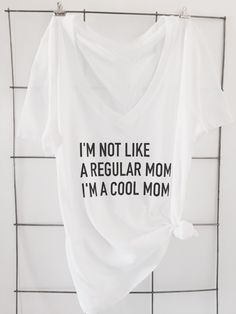 A personal favorite from my Etsy shop https://www.etsy.com/listing/267678778/not-a-regular-mom-t-shirt Mean girls, mean girls quotes, I'm not like a regular mom I'm a cool mom, mom t shirts, statement tees More