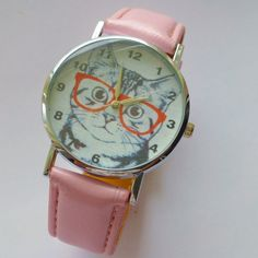 Cat wrist watch pink strap for Teenagers Women Girls....  DESCRIPTION: Fun wrist watch Wrist watch with pink strap Cat wearing glasses on watch face as images show The watch face surround is metal silver color The face is white with Cat image wearing specs fun design The strap is pink acrylic with silver color buckle strap Great gift idea for those loved ones The watch is quartz & comes with battery inside & checked All watches are opened inspected & checked before dispatch & sent in good…