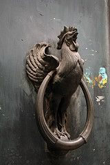 Rooster in Paris. Door knocker to old farm house! (bottom of the round brass pull is uncovered so it will bang against the roosters feet! keys-and-doors-and-knobs-oh-my