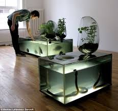 """River Plant Aquarium by Mathieu Lehanneur. A self contained living local river ecosystem for indoors. """"This aquarium is not only an interesting home décor piece, but also a fish hatchery and vegetable. Planted Aquarium, Aquarium Garden, Aquarium Design, Conception Aquarium, Mathieu Lehanneur, Cool Fish Tanks, Snake Tanks, Amazing Aquariums, Indoor Water Garden"""