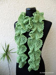 Looking for crocheting project inspiration? Check out Ruffle Lace Green Scarf With Red Rose by member Lyubava Crochet.