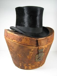Antique top hat and original leather box.