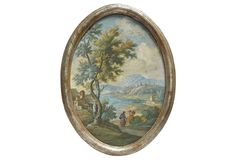 """Early-19th-century Italian oval landscape oil on canvas painting with silver leaf oval frame. Depicts a seaside mountain landscape with travelers on a village trail. Unsigned. Some surface wear and patina 