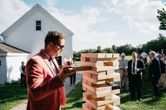 Must stay hydrated during giant jenga #casual #hydrationiskey #adultbeverage #giantjenga #maine #wedding #marryinmaine  Shot for Leah Fisher Photography for Sam and Joey's wedding at William Allen Farm! Check out her blog for more photos of this sweet wedding and adorable couple! >>>> http://ift.tt/2txPN3U @leahfisherphoto