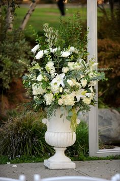 Wedding urn flowers by Floral Fields of Burbank, California. Photograph by Gavin Wade Photographers.