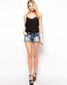 Pantaloncini corti jeans strappati