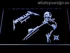 Metallica James Hetfield - LED neon light sign made of the highest quality clear plastic and briliant colorful LED illumination. The neon sign displays exactly the same from all angles thanks to the carving with the newest 3D laser engraving technology. This LED neon sign is a great gift idea! The neon is provided with a metal chain for displaying. Available in 3 sizes in following colours: Orange, Red, Blue, Green, Purple, White and Yellow!