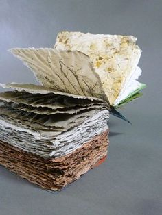 Maggie Puckett - Soil Horizons - an artist's book featuring layers of hand-made paper representing the layers of the earth's soil.