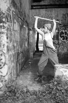 In my opinion much hotter then Miley Cyrus with a hammer  Berlin wall? woman, female, hammer, photo, crack, symbolism, black and white