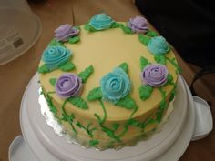 Final cake after taking Wilton's Basic Cake decorating - Course 1 offered at Micheal's stores. Roses : Tip 104. Leafs : Tip 352