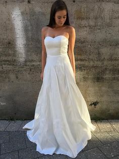 strapless gown thick, stiff stretch material fully lined boning in bodice full tulle under-skirt (puffy look)