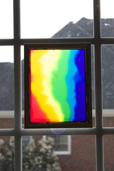Kids Art Activity:  Window Art made out of colored glue - what a fun kids art project!