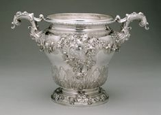 Wine Cooler by Paul de Lamerie, 1749. Victoria & Albert Museum.The style of this wine cooler, one of a pair, reflects the late use of some familiar motifs from de Lamerie's workshop. However silver marked by de Lamerie in the years before his death in 1751 is not as stylistically cohesive as his earlier work, raising the possibility that he was retailing wares from a broader range of makers.