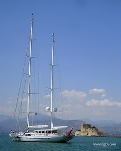 Yacht passing from #Bourtzi fortress as it leaves from #Nafplio in the #Peloponnese - #Greece