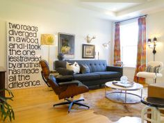 Brian & Brad's Artfully Modern Apartment -- Love the sofa. And the Robert Frost picture too!