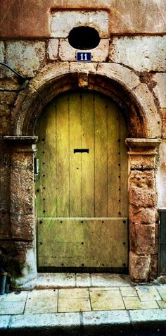 Brignoles, Var, France. This one looks brooding, serious and a bit scary. What happened behind this door?