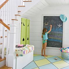 """I love the doors on this under-the-stairs closet.  (Even if the angled half-moons do look like """"angry eyes"""".)"""