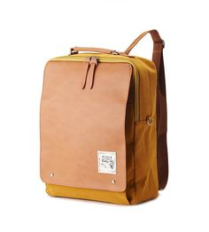 Cotton, synthetic leather - includes padded laptop pocket. Also available in other colours
