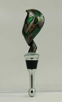 "Ganz Green Glass Wine Bottle Stopper Topper Gift Twisted NEW! by Ganz. $13.99. Ganz  Bella Casa Bottle Stopper  This beautiful wine bottle stopper is made with colored glass. The top is twisted in shape and the base is silver with a large rubber seal.  This stopper is 5.5"" tall.   Item # BC15320-4  This item is brand new and comes in a foam lined gift box.    International Buyers Welcome."