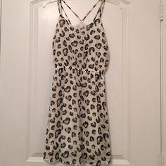 Leopard print dress Lightweight leopard print dress with cute strap detail in back. Worn 2-3 times Dresses