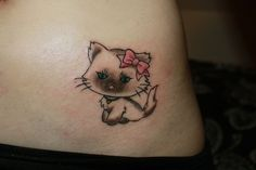 This looks identical to my kitties...and it's little and cute.  Could be an option for a very first tattoo :)