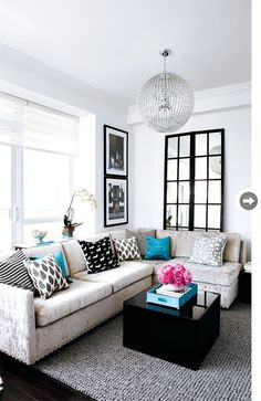 Living Room of interior designer Stacey Cohen. - - - - - - > Repurposed window with mirrors visually enlarges the room.