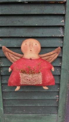 Primitive Folkart Angel Doll with heart pocket in red.....