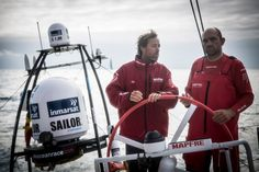 May 24, 2015. Leg 7 to Lisbon onboard MAPFRE. Day 07. Iker Martinez and Xabi Fernendez discussing options while both of them steer the boat