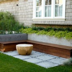 long concrete planter with wood seating and live wood table