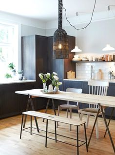 Dark cabinets, light wood table, subway tiles, open shelf, wooden cutting boards