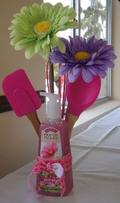 Cute bridal shower favor idea - hands soap with pink kitchen utensils and flowers {Courtesy of Indulgy}.