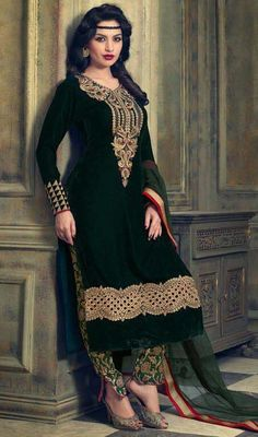 Take the fad to a whole new level with this black color embroidered net velvet silk pant style suit. The ethnic lace and resham work with a attire adds a sign of attractiveness statement for your look. #weddingwears #gorgeousdesigndress #lateststylishoutfits