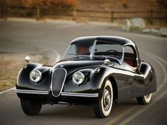This gorgeous vintage Jaguar will be the star at the RM Auction in Monterey this August. This 1954 Jaguar Roadster has been restored to prime condition. Several thousand of this model were produced in the early but few stand in a conditi Jaguar Xk120, Jaguar Xj, Jaguar F Type, Jaguar Cars, Sexy Cars, Hot Cars, Carros Jaguar, Jaguar Roadster, Vintage Cars