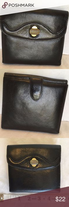 Cole Haan Womens Black Leather Bifold Wallet Title Cole Haan Womens Black Bifold Wallet with Change Purse Leather Bag Brand Cole Haan Style Bifold Wallet with change purse Size see pics for measurements Color black Material leather Features bi fold, snap clasp, 7 credit card slots, 1 ID slot, 2 bill slots. Flap change purse with twist lock and 2 compartments. Condition pre-owned. Very good condition. (see pics) Cole Haan Bags Wallets
