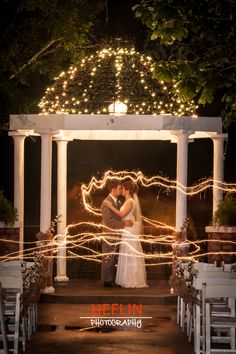 Unique Wedding Photography Idea. It's a long exposure shot with sparklers All they had to do was stand there very still and someone else ran around them with a sparkler. it's like a fairy tale! sparkler.  By HeflinPhotography  www.HeflinPhotography.com