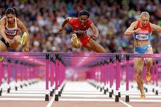 Kellie Wells (center) of the United States competes in a women's 100-meter hurdles semifinal. Wells, who won the gold medal in 2008, finished second in the final to Australia's Sally Pearson.