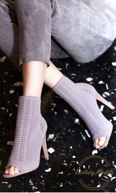 The Gianvito Rossi boots are constructed in Italy from soft stretch knit