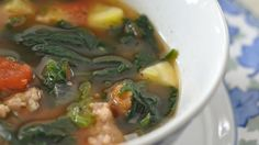 This soup is easy to put together, and the flavor of the spicy sausage is balanced nicely by Great Northern beans, zucchini, fresh spinach, and carrots.  Makes a delicious winter supper.