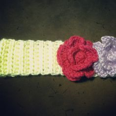 Adjustable Child into Teen hood headband made with a blend of soft acrylic and wool yarn in cream. Detachable hair clip flowers were made of the soft acrylic/wool blend yarn in lilac and 100% acrylic yarn in the hot pink. This headband has a clear button enclosure for easy adjustment. A grand total of $20 (child pricing) Order ready for Angie :)