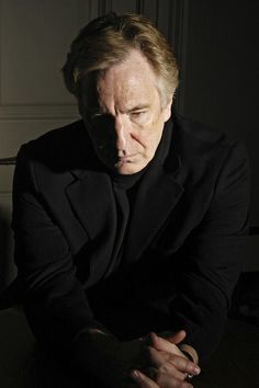 2004 - This is one of several photos of Alan Rickman taken during a photo-shoot at his home. The photos were taken by photographer Cambridge Jones. The photos were to raise funds for RADA.